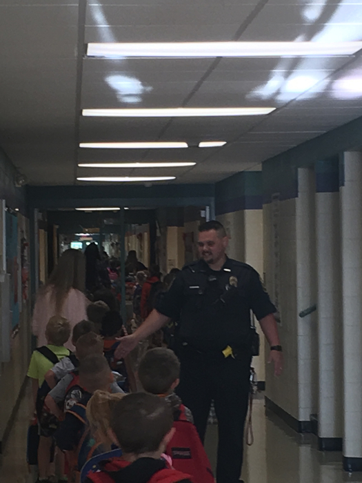Officer Swadley participating in our morning high five line!
